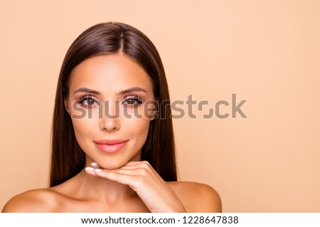 Brown-haired charming well-groomed dreamy leisure lifestyle lady with her naked shoulders she hold hand under chin look at camera isolated on pastel beige background with copy space for text #1228647838