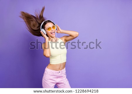 Photo of meloman lady with her cool casual outfit in trendy spectacles headset she isolated on shine violet purple background listen beat mp3 track playlist #1228694218