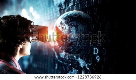 Experiencing virtual technology world. Mixed media #1228736926