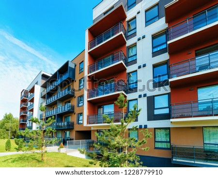 Modern apartment flat building real estate exterior concept. Outdoor residential home facilities. #1228779910