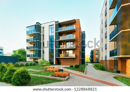 Modern new residential apartment house building complex, with outdoor facilities concept. With benches #1228868821