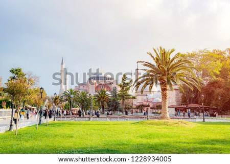 Hagia Sophia, Istanbul, Turkey, Octorber 13, 2018 : People are visiting Hagia Sophia In Autumn leaves. #1228934005