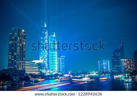 Bangkok Thailand - November 10, 2018: Icon Siam river side department store grand opening with light and laser show at Chaophraya River Bangkok, New big  shopping mall in Bangkok, Thailand #1228942636