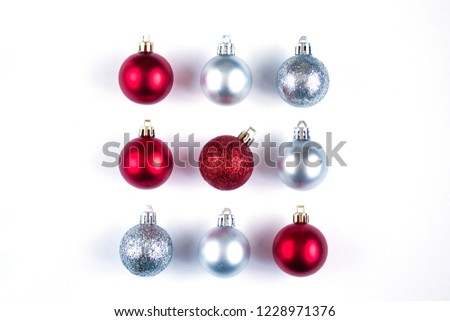 Nine Christmas red and silver balls with shadows on a white background. New Year's composition. square #1228971376