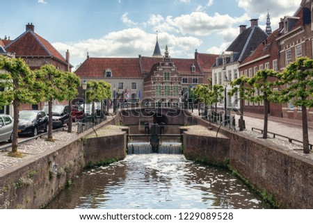 The canal Eem in the old town of the city of Amersfoort in The Netherlands #1229089528