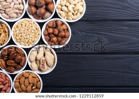 Mix of nuts : Pistachios, almonds , walnuts , pine nut , hazelnuts and cashew . Snack in bowl backgrond #1229112859