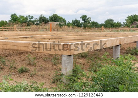 On pile foundations support the floor of a frame house #1229123443