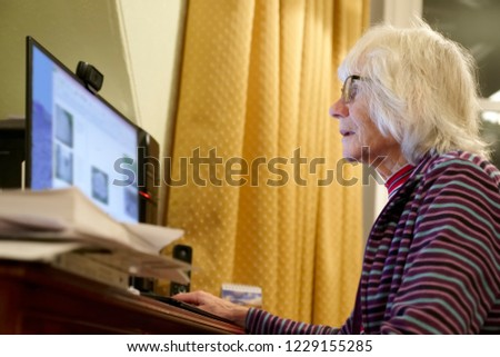Old elderly senior person learning computer and online internet skills  #1229155285