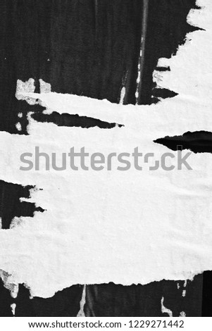 Old grunge ripped torn vintage collage posters creased crumpled paper surface placard texture background backdrop empty space for text  #1229271442