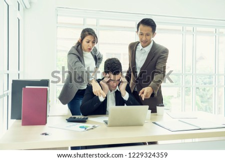 business, teamwork, people and crisis concept. business team sitting  solving problem in office. businessmen and women serious argument negative emotion . #1229324359