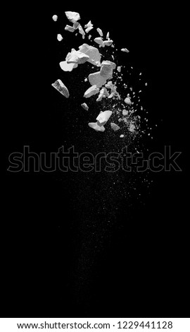 broken debris caused by explosion against black background Royalty-Free Stock Photo #1229441128