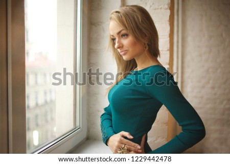 Young and beautiful russian girl posing at the studio #1229442478