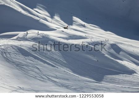 Matrei in Osttirol, Grossglockner Resort, Austria. Snowy slope. Mountains in the background. #1229553058
