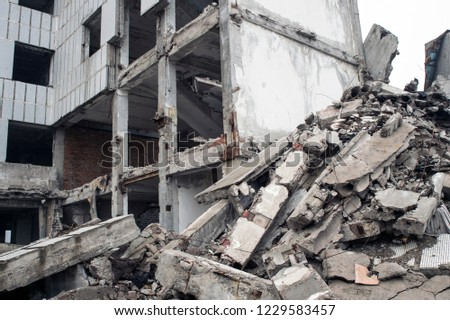 A huge pile of gray concrete debris from piles and stones of the destroyed building. The impact of the destruction. Background. #1229583457