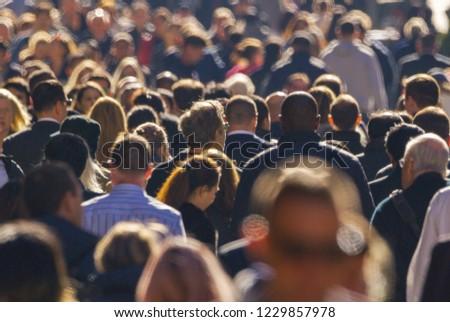 Crowd of people walking street  #1229857978