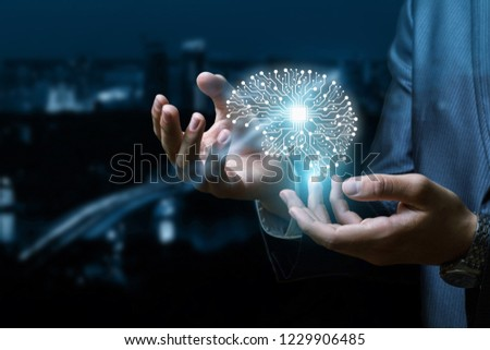 A digital brain model is going up from the businessman 's hands at the busy night city background. The concept is the extensive unconventional thinking. #1229906485