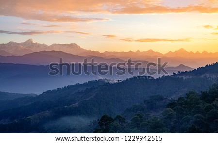 Himalaya mountain range at sunrise with moody sky as seen from Kausani Uttarakhand India. #1229942515