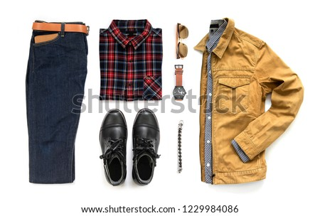 Creative fashion design for men casual clothing set with black boot , watch, blue jeans, belt, wallet, sunglasses, office shirt, yellow jacket and bracelet isolated on a white background, Top view Royalty-Free Stock Photo #1229984086