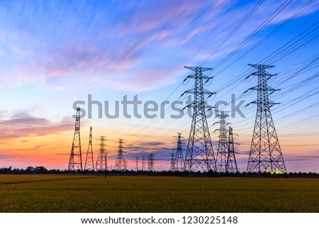 high-voltage power lines at sunset,high voltage electric transmission tower #1230225148