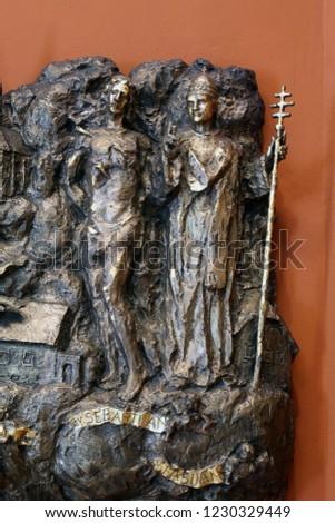 ZAGREB, CROATIA - MARCH 31: Saints Sebastian and Fabian, bas relief in Chapel of Saint Dismas in Zagreb, Croatia on March 31, 2015 #1230329449