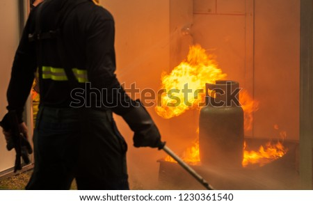 Basic Fire Fighting and Evacuation Fire Drill Training For Safety in Condominium #1230361540