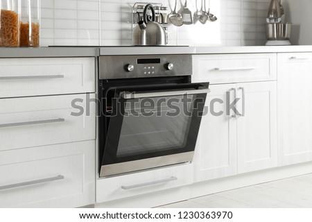 Open modern oven built in kitchen furniture #1230363970