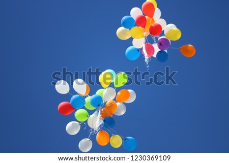 assorted-color balloons flying on sky during daytime #1230369109