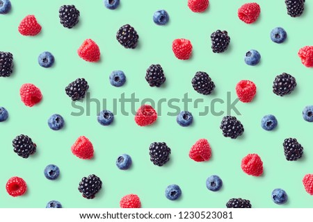 Colorful fruit pattern of wild berries on blue background. Raspberries, blueberries and blackberries. Top view. Flat lay #1230523081