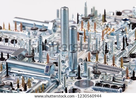 teners - bolts, nuts, washers, screws, saws, popnets, dowels, anchors, hinges, folds, rivets, Royalty-Free Stock Photo #1230560944
