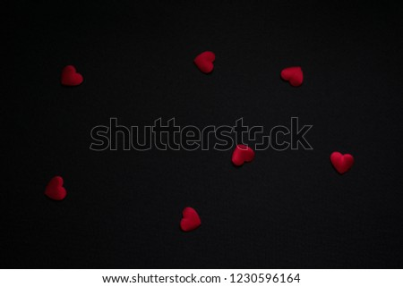 Valentines day background with red hearts on black background #1230596164