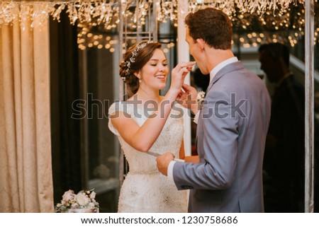 Happy couple Cutting the Wedding Cake on Wedding Day #1230758686