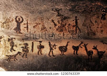 MAGURATA, BULGARIA - OCTOBER 15, 2013: Prehistoric mural drawings in Magura cave #1230763339
