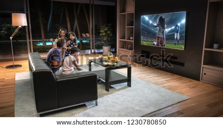 A family is watching a soccer moment on the TV and celebrating a goal, sitting on the couch in the living room. The living room is made in 3D. #1230780850