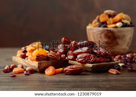 Various dried fruits and nuts on a old wooden table. #1230879019