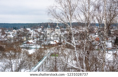 View of town Vereya, Church of the Epiphany and bridge over river Protva in winter, Naro-Fominsky District, Moscow Oblast,  Russia #1231028737