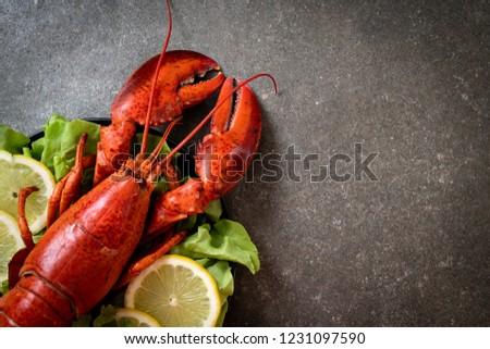 freshly boiled lobster with vegetable and lemon #1231097590