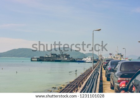 Phuket, Thailand - December 26, 2017 : A Row of Parked Cars Curving around Bend in Pier Road. #1231101028