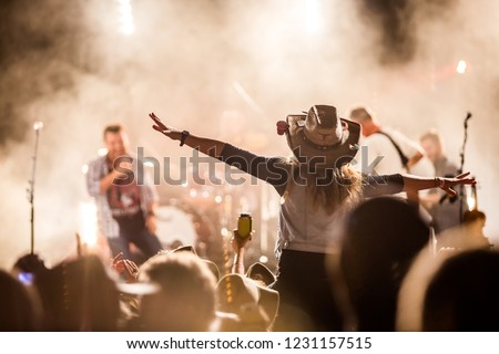 Music festival crowd excitement Royalty-Free Stock Photo #1231157515