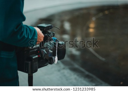 Cameraman hold video camera working on street #1231233985
