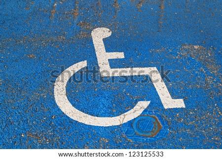 Handicapped sign at asphalt for disabled parking #123125533