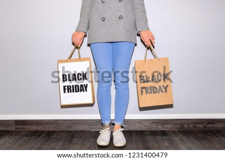 Partial view of a woman holding a black friday package #1231400479