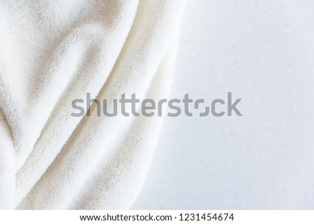 White delicate soft background of plush fabric folds on white background. Copy space. Flat lay. #1231454674