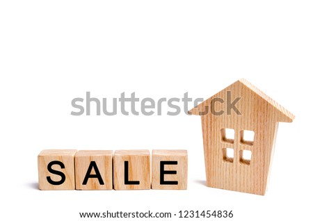 wooden house with the inscription sale on white isolated background. sale of property, home. affordable housing. sale of apartments. real estate agent services. realtor #1231454836