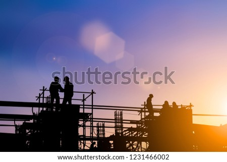 Silhouette of engineer and construction team working at site over blurred background for industry background with Light fair. #1231466002
