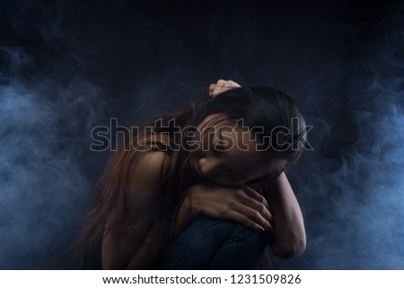 White Smoke Tan Skin Asian Woman black straight hair with Dense Fluffy Puffs of Fog on dark Background, Abstract high low exposure contrast, copy space for text logo, broken heart lonely girl can cry #1231509826