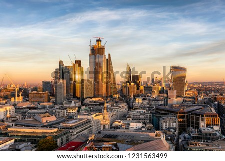 Sunset over the urban skyline of the financial district City of London, United Kingdom #1231563499