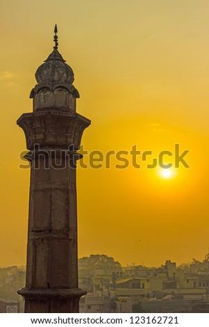 minaret in Delhi in morning sun #123162721