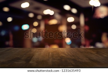 Empty dark wooden table in front of abstract blurred bokeh background of restaurant . can be used for display or montage your products.Mock up for space #1231635493