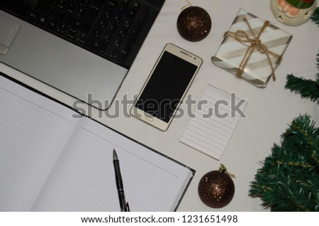 White office desk table with blank notebook, laptop and other office supplies. Top view with copy space, flat lay. #1231651498