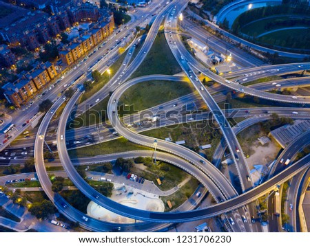 Aerial view of lighted highway road junctions at night #1231706230